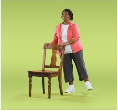 Woman demonstrating side leg raise