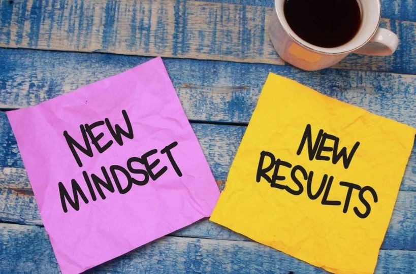 Two sticky notes saying new mindset and new results